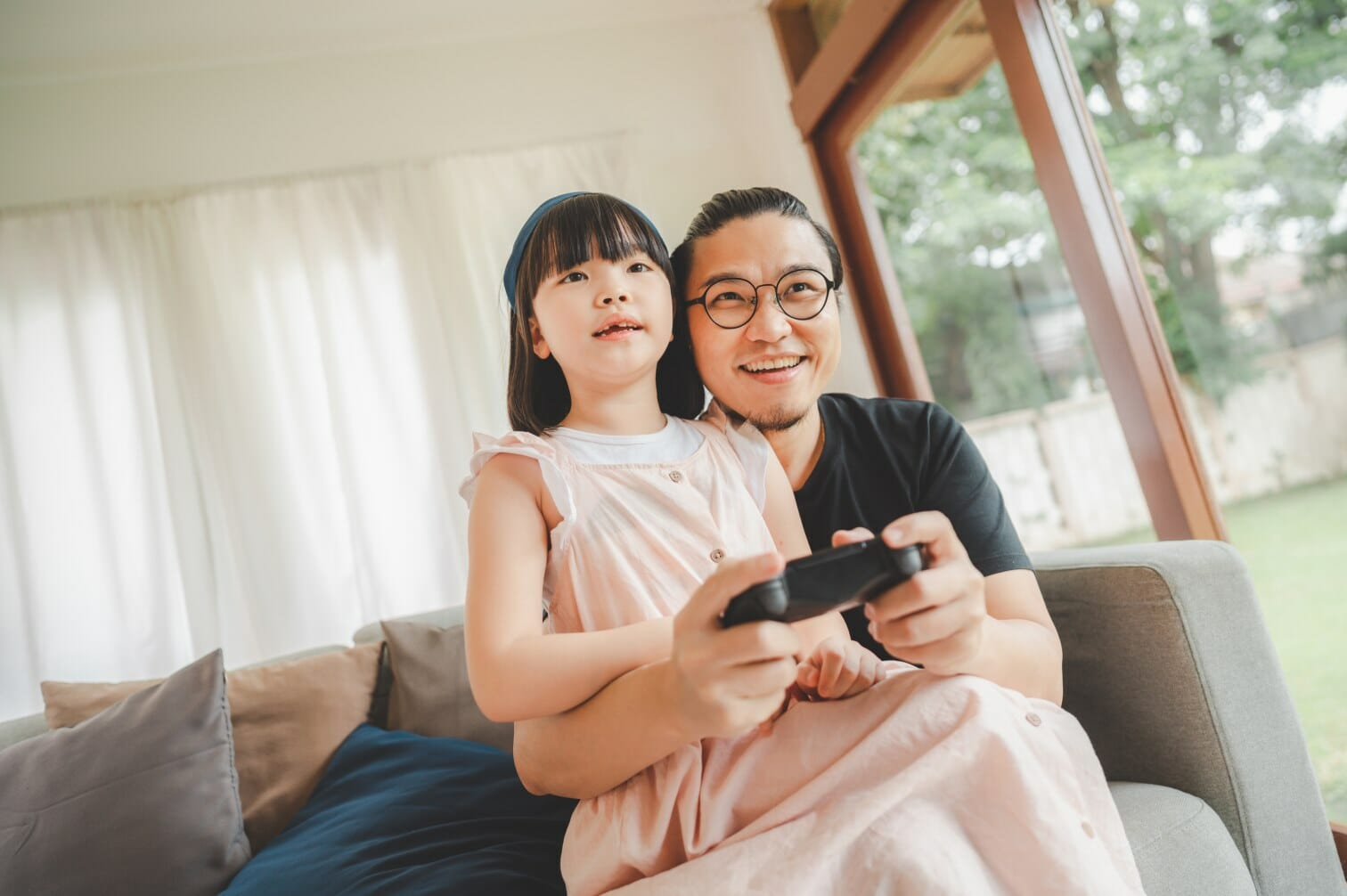 father-and-daughter-playing-video-game